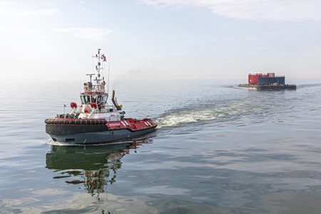 ASD tug Waterstraat tows cable reels to Eemshaven