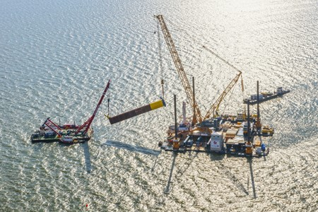Floating crane Triton closely involved in construction of Fryslân Wind Farm