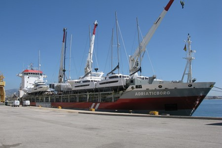 MV Adriaticborg loads yachts  in the Mediterranean for the Far East